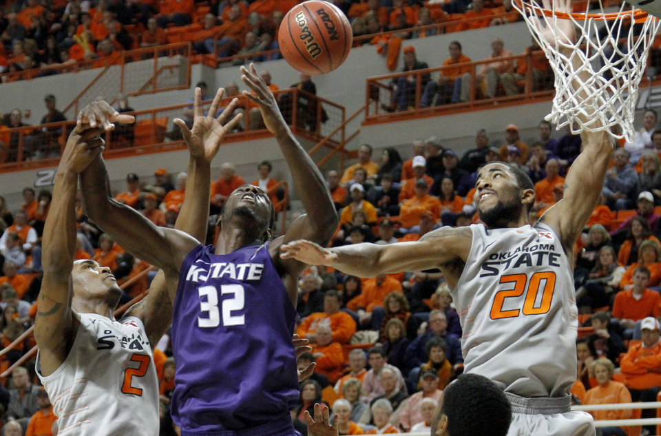 Kansas State's Jamar Samuels (32) fights for the rebound between Oklahoma State's Le'Bryan Nash (2) and Michael Cobbins (20) during an NCAA college basketball game between the Oklahoma State University Cowboys (OSU) and the Kansas State University Wildcats (KSU) at Gallagher-Iba Arena in Stillwater, Okla., Saturday, Jan. 21, 2012. Photo by Bryan Terry, The Oklahoman