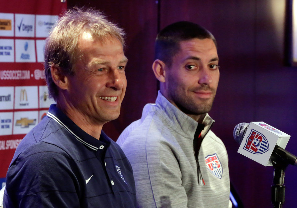 Photo - U.S. men's soccer coach Jurgen Klinsmann, left, and World Cup team captain Clint Dempsey answer questions during a news conference, in New York, Friday, May 30, 2014. The U.S. World Cup team is holding a pep rally in Times Square leading to Sunday's exhibition against Turkey, the second of three warmup matches for the Americans before next month's tournament in Brazil. (AP Photo/Richard Drew)