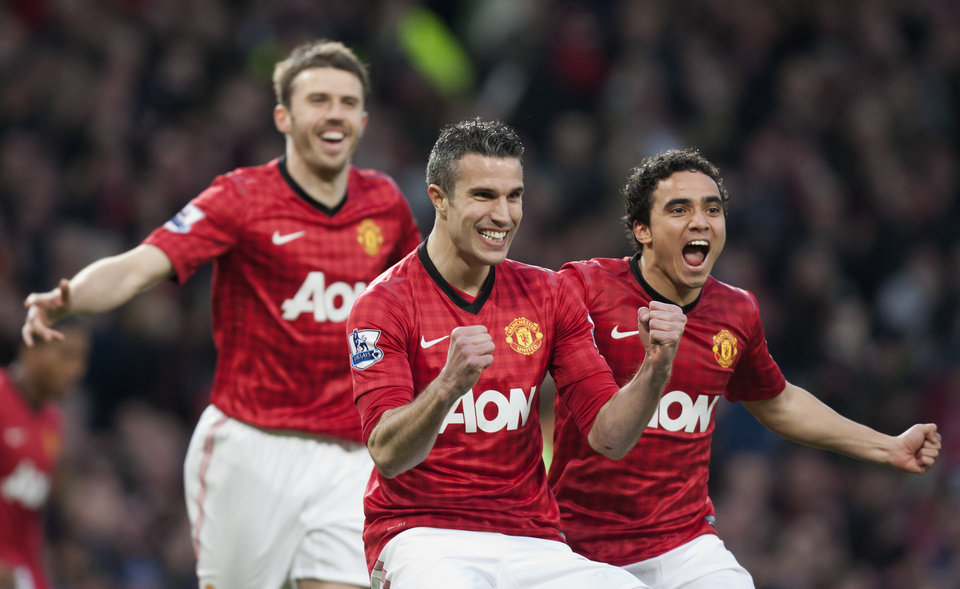 Manchester United's Robin van Persie, centre, celebrates after scoring against Aston Villa during their English Premier League soccer match at Old Trafford Stadium, Manchester, England, Monday April 22, 2013. (AP Photo/Jon Super)