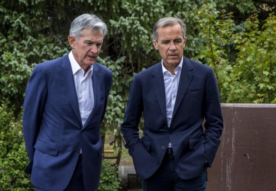 Photo -  Federal Reserve Chairman Jerome Powell, left, and Bank of England Governor Mark Carney walk together after Powell's speech at the Jackson Hole Economic Policy Symposium on Friday in Jackson Hole, Wyo. [AP PHOTO]