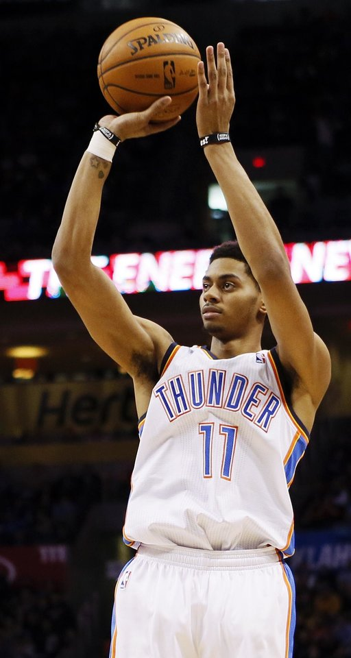 Oklahoma City's Jeremy Lamb (11) takes a shot during an NBA basketball game between the Oklahoma City Thunder and the San Antonio Spurs at Chesapeake Energy Arena in Oklahoma City, Wednesday, Nov. 27, 2013. Oklahoma City won, 94-88. Photo by Nate Billings, The Oklahoman