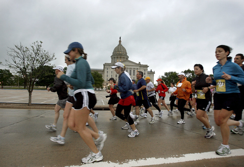 Marathon runners run past the State Capitol during the 8th annual Oklahoma City Memorial Marathon on Sunday, April 27, 2008, in Oklahoma City, Okla.