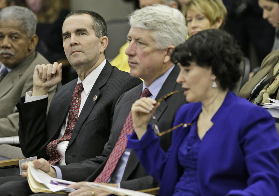 Photo - State Sen. Ralph Northam, left, D-Accomack, listens to testimony along with Sen. Mark Herring, D-Loudon, center, and Sen. Barbara Favola, D-Arlington, right, during a meeting of the Senate Health Education and Welfare committee at the Capitol Thursday, Jan. 17, 2013 in Richmond, Va. The committee killed Northam's bill that would  have repealed the mandatory ultrasound statute. (AP Photo/Steve Helber)