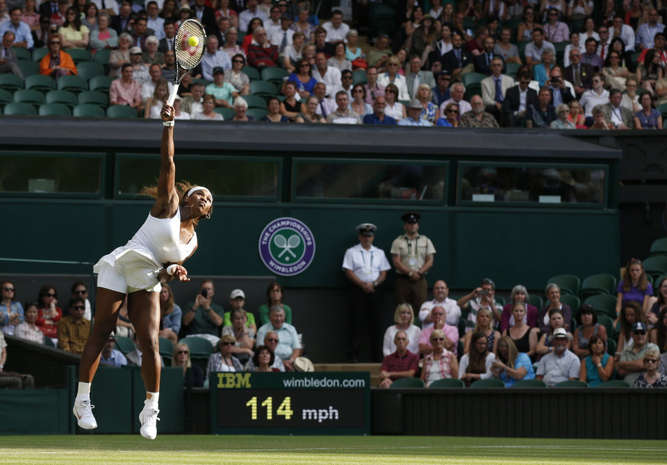 Photo - Serena Williams of U.S. serves to Anna Tatishvili of U.S. during their first round match at the All England Lawn Tennis Championships in Wimbledon, London, Tuesday, June 24, 2014. (AP Photo/Sang Tan)
