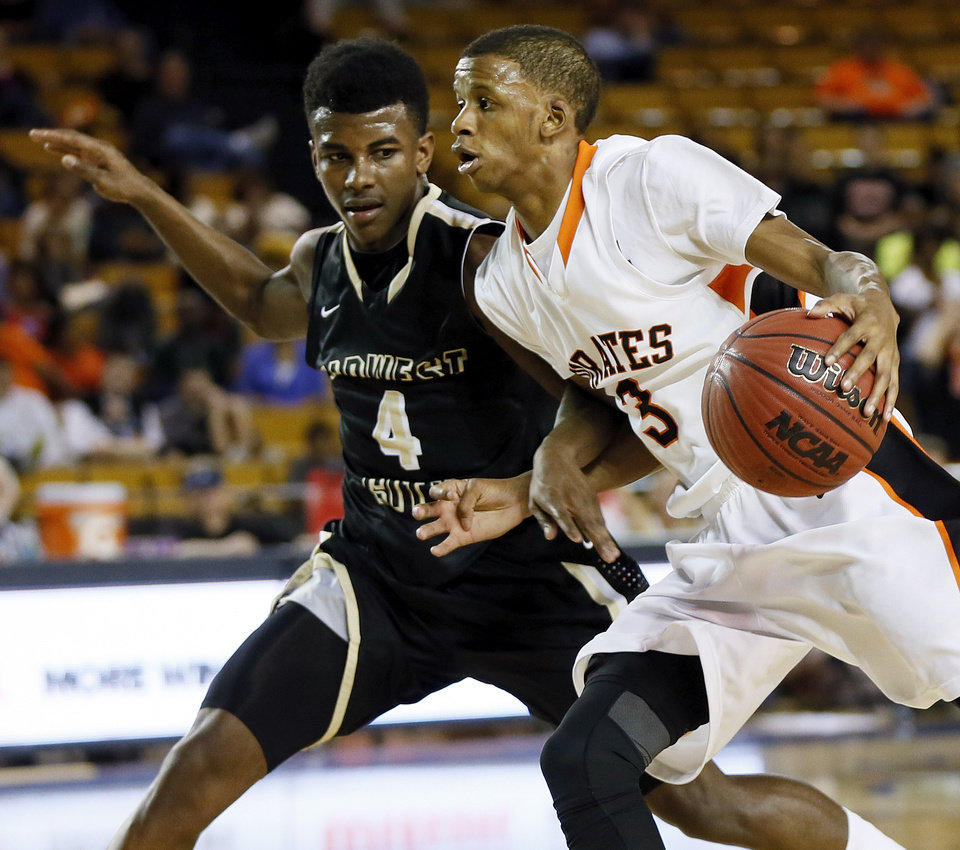 Putnam City's Ronnie Boyce (3) drives against Midwest City's Kesean Brown (4) during a Class 6A boys high school basketball game in the semifinals of the state tournament at the Mabee Center in Tulsa, Okla., Friday, March 8, 2013. Photo by Nate Billings, The Oklahoman
