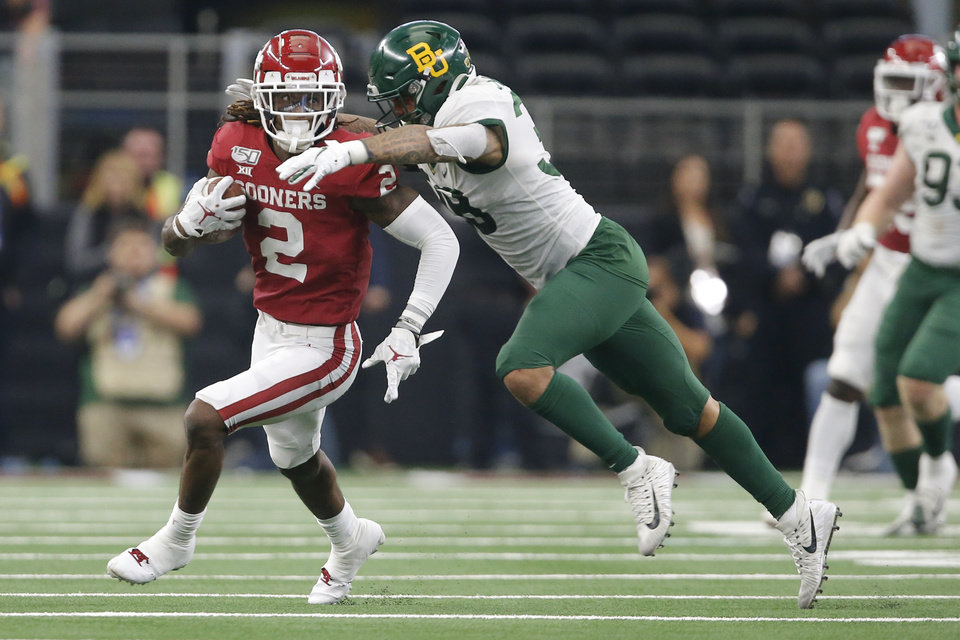 Photo - Oklahoma's CeeDee Lamb (2) is brought down by Baylor's Jordan Williams (38) during the Big 12 Championship Game between the University of Oklahoma Sooners (OU) and the Baylor University Bears at AT&T Stadium in Arlington, Texas, Saturday, Dec. 7, 2019. Oklahoma won 30-23. [Bryan Terry/The Oklahoman]
