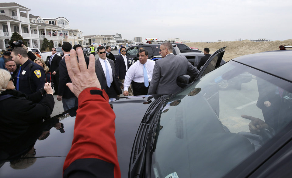 Photo - New Jersey Gov. Chris Christie, center, is greeted Wednesday, Jan. 9, 2013, in Belmar, N.J., as officials kicked off the construction on a 1.3-mile boardwalk to replace the walkway destroyed by Superstorm Sandy in October. The goal is to have it done by May. (AP Photo/Mel Evans)