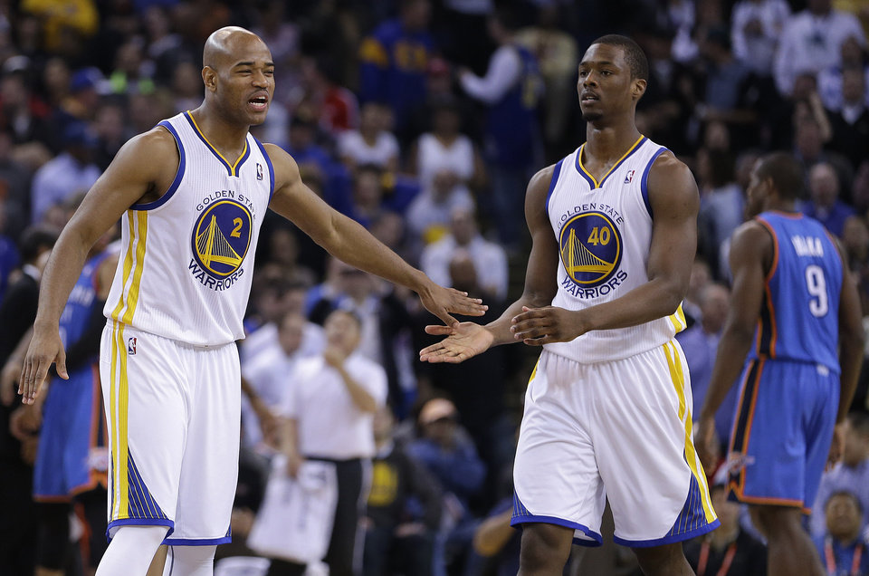 Photo - Golden State Warriors' Jarrett Jack, left, and Harrison Barnes (40) celebrate during a timeout in the second half of an NBA basketball game against the Oklahoma City Thunder Wednesday, Jan. 23, 2013, in Oakland, Calif. (AP Photo/Ben Margot)