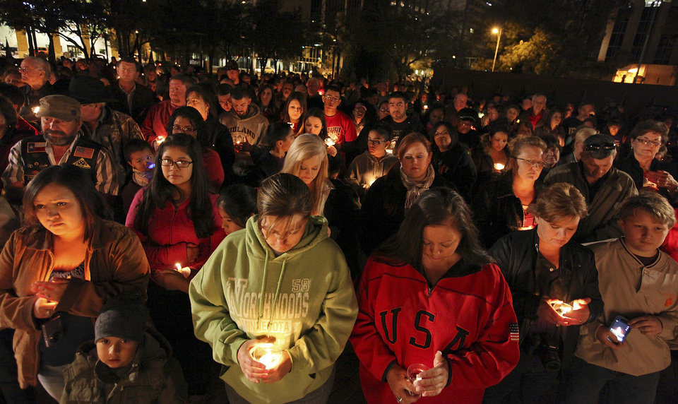Photo -   About 200 people attend a candlelight vigil held at Centennial Plaza in Midland, Texas on Saturday, Nov. 17, 2012 in honor of the people involved in an accident where a Union Pacific train struck a float carrying military veterans on Thursday Nov. 15, 2012. Four veterans were killed, including one from the San Antonio area. (AP Photo/San Antonio Express-News, Edward A. Ornelas)