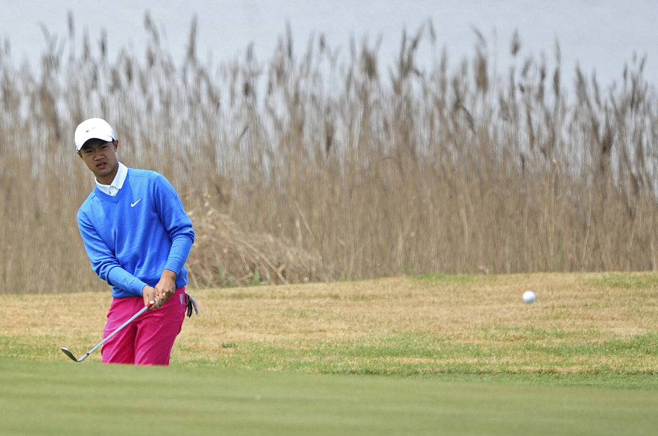 Photo - 12-year-old Chinese amateur golfer Ye Wocheng watches his shot on the second day of the Volvo China Open at the Tianjin Binhai Lake Golf Club in north China's Tianjin Municipality Friday, May 3, 2013. Ye became the youngest player ever to compete in a European Tour event. (AP Photo) CHINA OUT