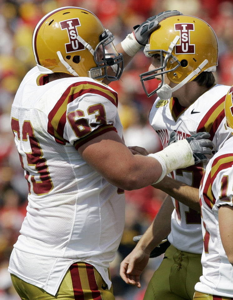 Photo - FILE - In this Sept. 15, 2007, file photo, Iowa State kicker Bret Culbertson, right, celebrates with teammate Ben Lamaak after making a field goal during the first half of a college football game against Iowa in Ames, Iowa. With uneven testing for steroids and inconsistent punishment, college football players are packing on significant weight _ in some cases, 30 pounds or more in a single year _ without drawing much attention from their schools or the NCAA in a sport that earns tens of billions of dollars for teams. Lamaak, who arrived at Iowa State in 2006, said he weighed 225 pounds in high school and 262 pounds in the summer of his freshman year on the Cyclones football team. A year later, official rosters showed the former basketball player from Cedar Rapids weighed 306, a gain of 81 pounds since high school. He graduated as a 320-pound offensive lineman and said he did it all naturally.