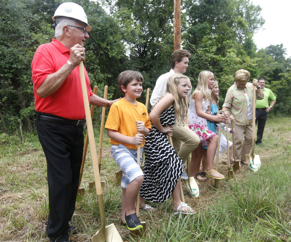 Photo - Former Edmond Mayor Carl Reherman stands alongside his grandchildren in a ground-breaking ceremony at a new park at Arcadia Lake that is being named after him. PHOTO BY PAUL HELLSTERN, THE OKLAHOMAN  PAUL HELLSTERN - OKLAHOMAN