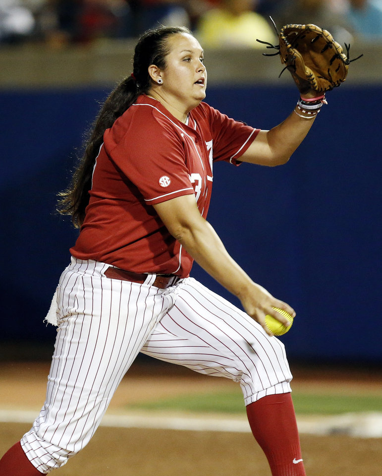 Photo - Alabama's Jaclyn Traina (33) pitches during Game 6 of the Women's College World Series softball tournament between Alabama and Kentucky at ASA Hall of Fame Stadium in Oklahoma City, Friday, May 30, 2014. Alabama won, 2-0. Photo by Nate Billings, The Oklahoman