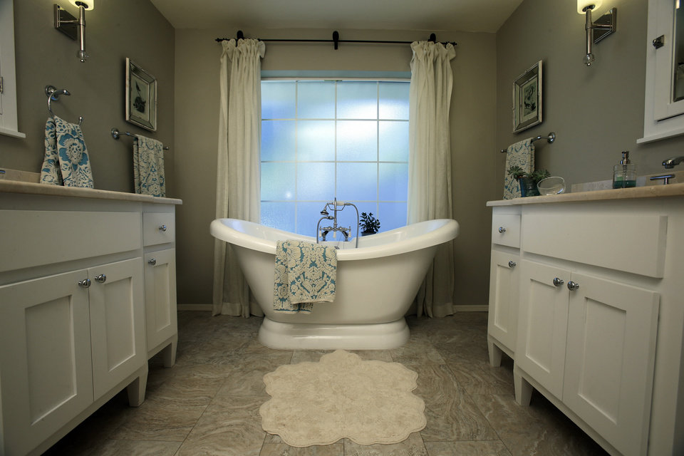 Eilizabeth Greenhey's master bathroom features separate vanities and a luxurious tub on Tuesday, Nov. 6, 2012 in Norman, Okla.  Photo by Steve Sisney, The Oklahoman