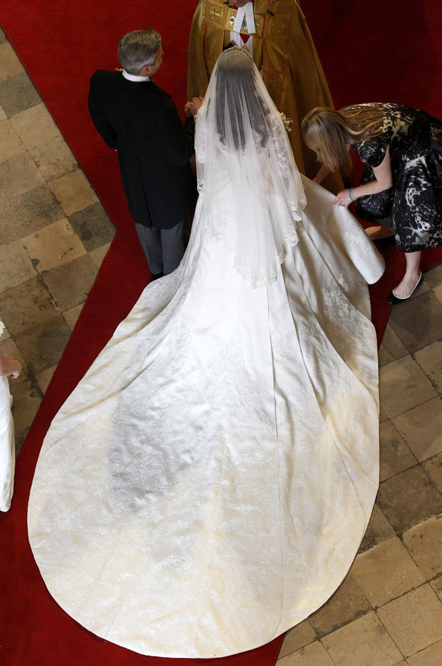 Photo - Kate Middleton has her dress adjusted as she arrives with her father Michael at Westminster Abbey before her marriage to Britain's Prince William in central London April 29, 2011.  (AP Photo/Suzanne Plunkett, Pool)  ORG XMIT: RWAJP108