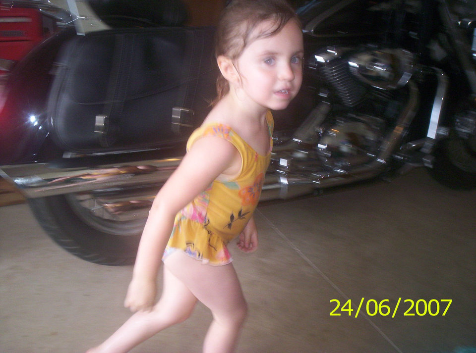 Little Alysia running past her Grandpa's motorcycle after playing in the sprinkler..<br/><b>Community Photo By:</b> Aunt TAMA<br/><b>Submitted By:</b> Tama, Midwest