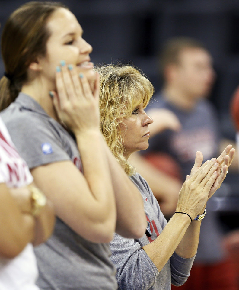 Photo - OU coach Sherri Coale watches her team practice next to Whitney Hand (25) during the press conference and practice day at the Oklahoma City Regional for the NCAA women's college basketball tournament at Chesapeake Energy Arena in Oklahoma City, Saturday, March 30, 2013. Photo by Nate Billings, The Oklahoman