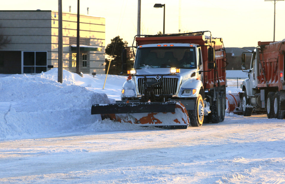 Photo - Snow plows working on Britton Road just east of the Broadway Extension at sunrise in Oklahoma City Wednesday, Feb. 2, 2011. Photo by Paul B. Southerland, The Oklahoman