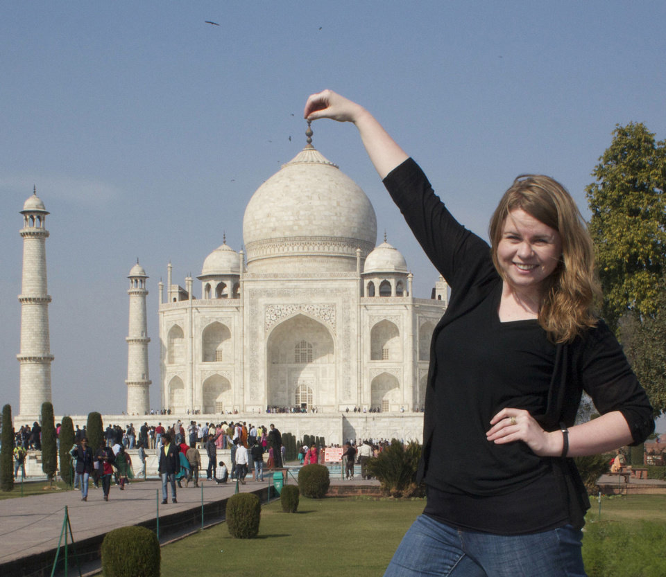 NewsOK editor Lindsay Houts has some fun with perspective outside the Taj Mahal in Agra, Inda. She is in the country for four weeks with Rotary International, sent by the Oklahoma City chapter. PHOTO PROVIDED
