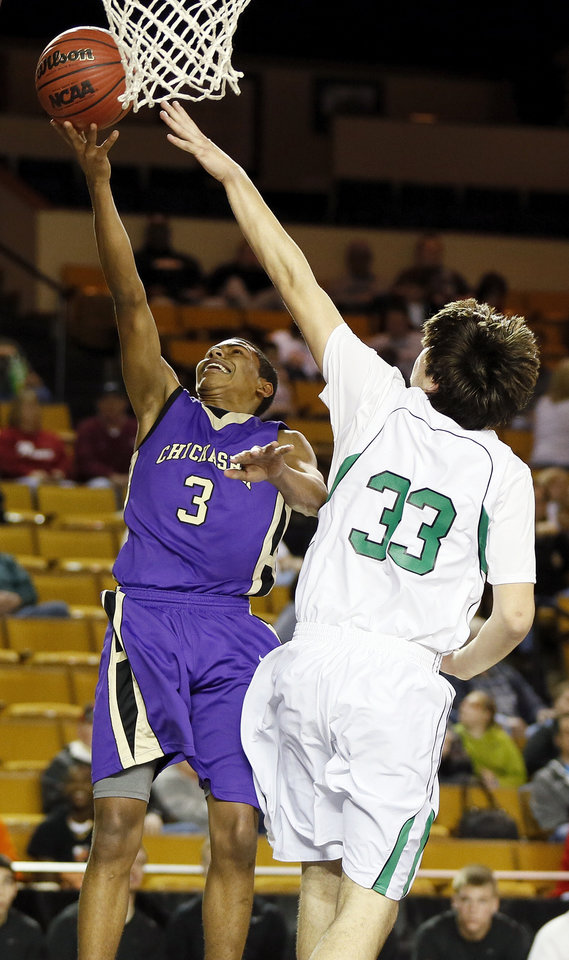 Chickasha's E.J. Golightly (3) takes a shot against Bishop McGuinness' Will Lienhard (33) during a Class 5A boys high school basketball game in the semifinals of the state tournament at the Mabee Center in Tulsa, Okla., Friday, March 8, 2013. Bishop McGuinness beat Chickasha, 50-40. Photo by Nate Billings, The Oklahoman