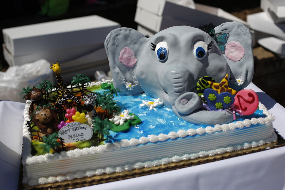 Photo - A birthday cake during Malee's Second Birthday Bash at the Oklahoma City Zoo, Sunday, April 14, 2013.  Photo by Garett Fisbeck, For The Oklahoman