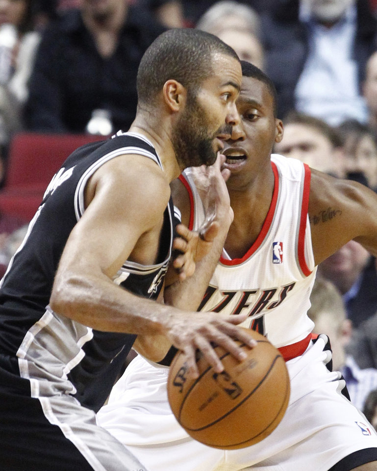 San Antonio Spurs guard Tony Parker, left, drives on Portland Trail Blazers guard Nolan Smith during the first quarter of an NBA basketball game in Portland, Ore., Thursday, Dec. 13, 2012. (AP Photo/Don Ryan)