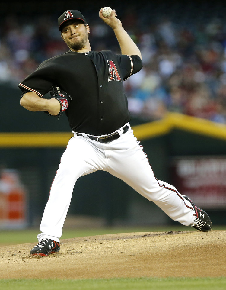 Photo - Arizona Diamondbacks pitcher Wade Miley delivers against the San Diego Padres during the first inning of a baseball game on Saturday, May 25, 2013, in Phoenix. (AP Photo/Matt York)