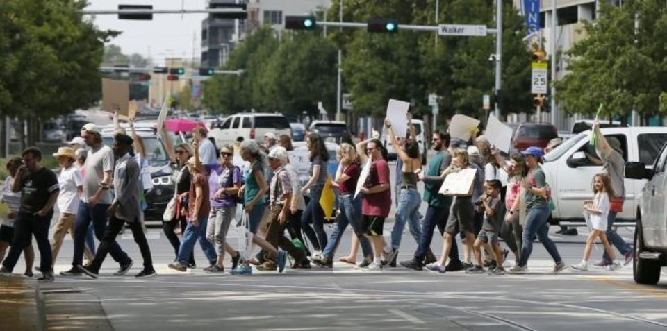 Photo -  People cross Sheridan Avenue as they march south on Hudson Avenue during the Oklahoma City Climate Strike. [Nate Billings/The Oklahoman]