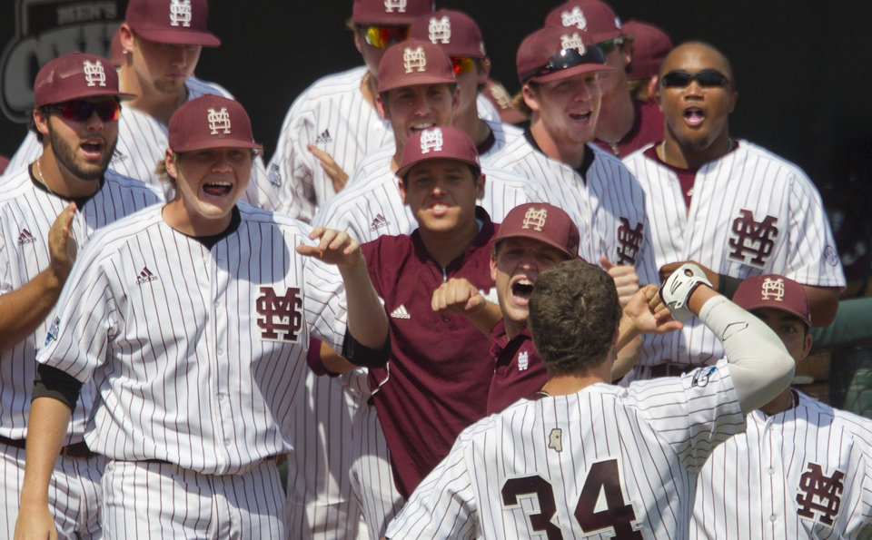 Photo - Mississippi State's Hunter Renfroe (34) is congratulated on his three-run home run in the fifth inning of an NCAA College World Series baseball game against Oregon State in Omaha, Neb., Friday, June 21, 2013. Mississippi State won 4-1. (AP Photo/The Oregonian, Ross William Hamilton)  MAGAZINES OUT; TV OUT; LOCAL TV AND INTERNET OUT; (THE MERCURY, WILLAMETTE WEEK, PAMPLIN MEDIA GROUP OUT