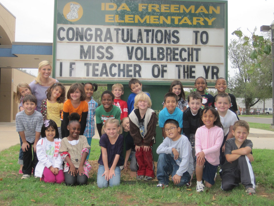 Edmond Rotary Club recently honored \'Teacher of the Year\' Heidi Volbrecht, pictured with her first-grade class recently in front of Ida Freeman Elementary School.
