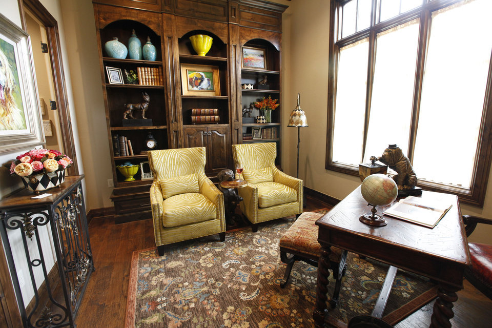 Photo - The study at 15820 Chapel Ridge Road, one of three news homes in the Show House event, is made for reading and reflection.  PAUL HELLSTERN - The Oklahoman