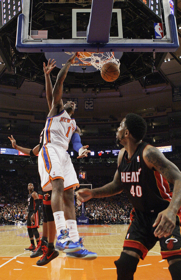 Photo -   New York Knicks' Amare Stoudemire (1) dunks the ball as Miami Heat's Udonis Haslem (40) looks on during the first half of Game 4 of an NBA basketball first-round playoff series at Madison Square Garden, Sunday, May 6, 2012, in New York. (AP Photo/Frank Franklin II)