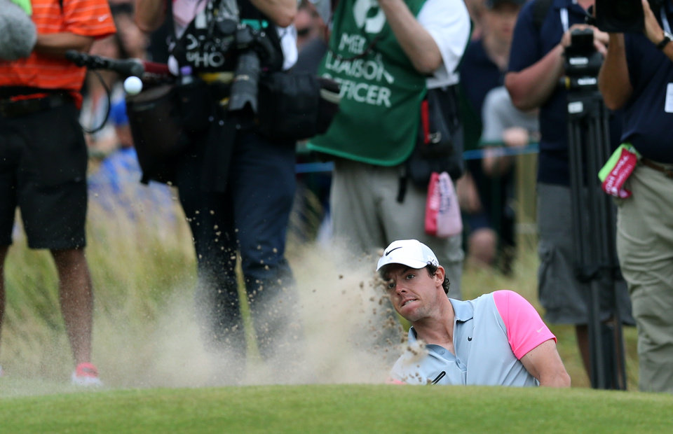 Photo - Rory McIlroy of Northern Ireland hits out of the bunker onto the 18th green during the final round of the British Open Golf championship at the Royal Liverpool golf club, Hoylake, England, Sunday July 20, 2014. (AP Photo/Scott Heppell)