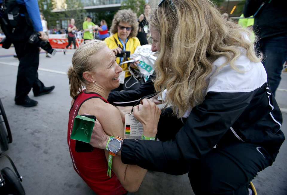 Photo -  Stephanie Andre, who won the women's race in record time, speaks with former record holder Camille Herron after finishing  the Oklahoma City Memorial Marathon in Oklahoma City, Sunday, April 28, 2019. [Bryan Terry/The Oklahoman]