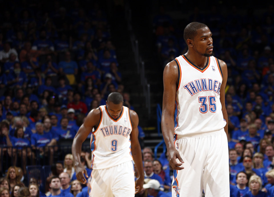 Oklahoma City's Kevin Durant (35) and Serge Ibaka (9) react to a play during Game 1 of the Western Conference semifinals in the NBA playoffs between the Oklahoma City Thunder and the Los Angeles Clippers at Chesapeake Energy Arena in Oklahoma City, Monday, May 5, 2014. Photo by Sarah Phipps, The Oklahoman