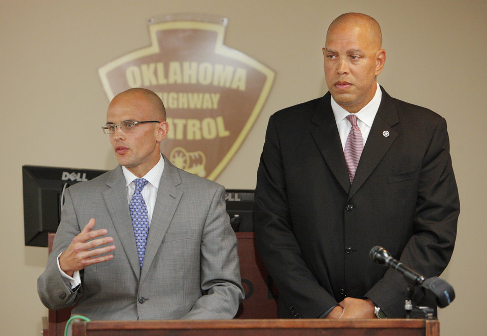 Photo - Oklahoma Highway Patrol Capt. Jason Holt, left, and Oklahoma Department of Safety Commissioner Michael Thompson answer a question from a reporter during a news conference in Oklahoma City, Thursday, Sept. 4, 2014, about the investigation into the execution of inmate Clayton Lockett.  Photo by Paul B. Southerland, The Oklahoman