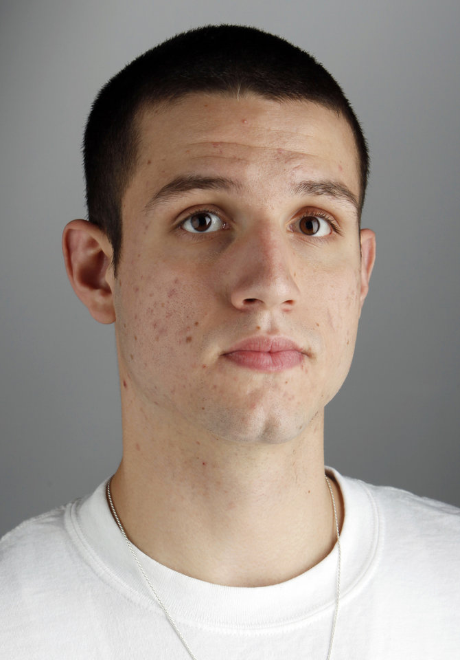Photo - All-State high school basketball player Matt Qualls, Tahlequah, poses for a mug shot at the OPUBCO studio in Oklahoma City, Wednesday, April 8, 2009. Photo by Nate Billings, The Oklahoman ORG XMIT: KOD