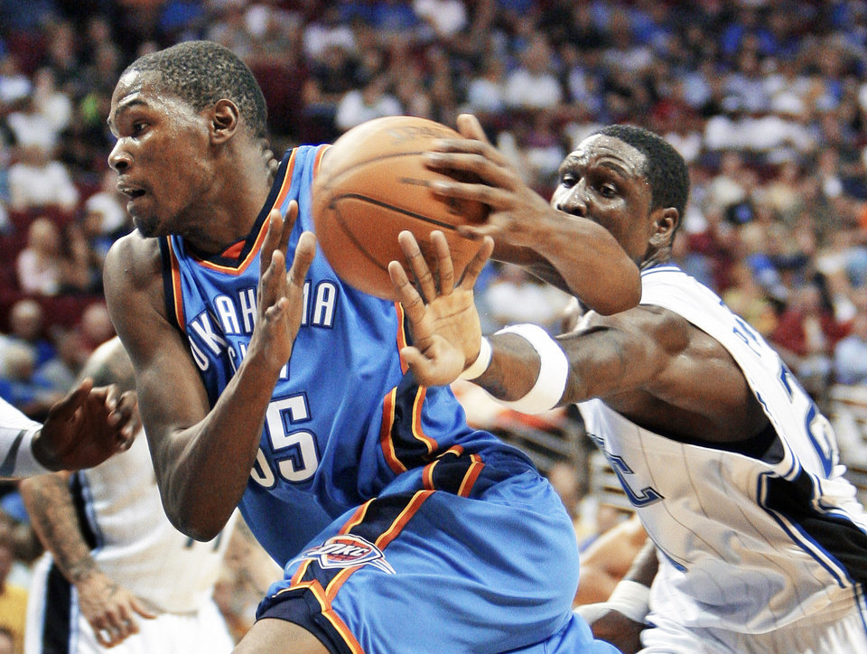 Oklahoma City forward Kevin Durant, left, drives to the basket past Orlando's Mickael Pietrus during action Wednesday night. AP photo