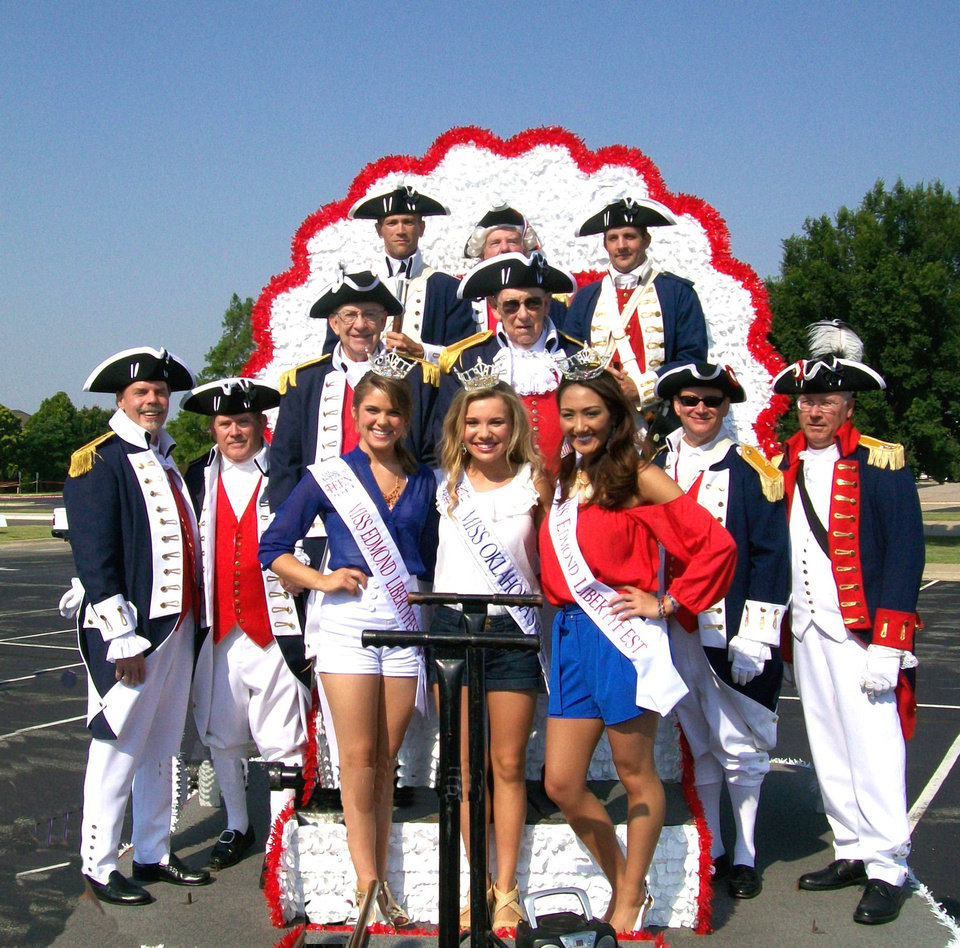 Sons of the American Revolution members who participated in the July 4 parade in Edmond included, back row,from left, Mike Sanford, Ron Schroff and Cory Shipman. Middle row: past president Wayne Nash and Howard Ferrell Front row: president Martin Reynolds, Al Lankford, Henry Baer, past president Glen Fast and  Miss Oklahoma Outstanding Teen Ashton Vincent, Miss Edmond LibertyFest Outstanding Teen Joei Whisenant and Miss Edmond LibertyFest Queen Veronica Wisniewski. PHOTO PROVIDED  <strong></strong>