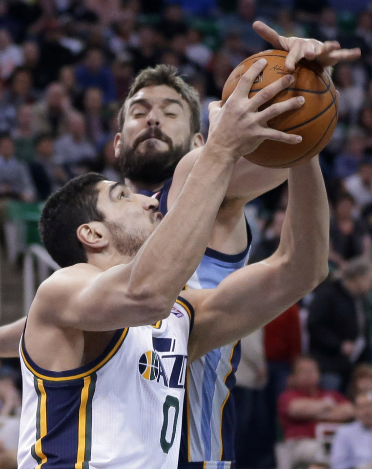 Photo - Memphis Grizzlies' Marc Gasol, rear, of Spain, defends Utah Jazz's Enes Kanter (0), of Turkey, during the first quarter of an NBA basketball game Wednesday, March 26, 2014, in Salt Lake City. (AP Photo/Rick Bowmer)