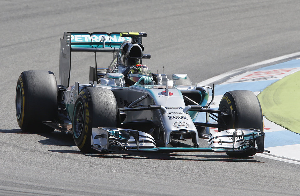 Photo - Mercedes driver Nico Rosberg of Germany races during the third practise session of the German Formula One Grand Prix in Hockenheim, Germany, Saturday, July 19, 2014. The German Grand Prix will be held on Sunday.(AP Photo/Michael Probst)