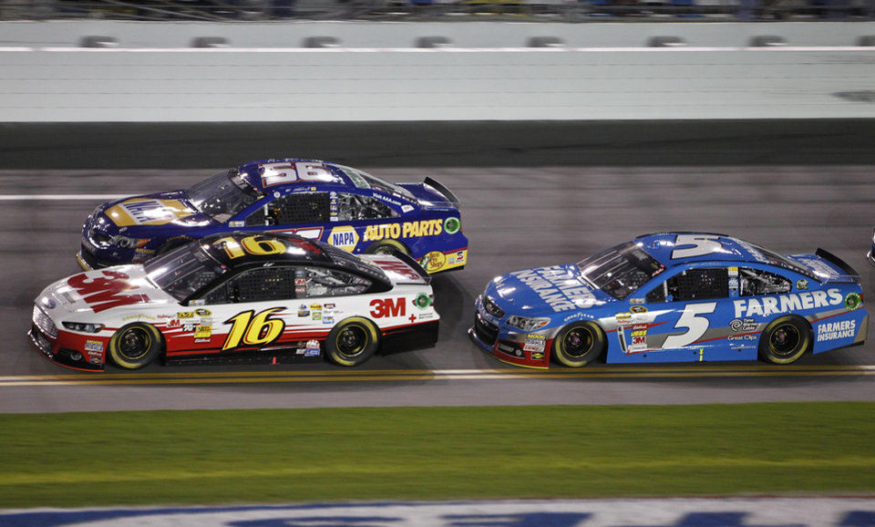Photo - Greg Biffle (16), Martin Truex Jr. (56) and Kasey Kahne (5) race through the front stretch early in the NASCAR Sprint Unlimited auto race at Daytona International Speedway, Saturday, Feb. 16, 2013, in Daytona Beach, Fla. (AP Photo/Terry Renna)