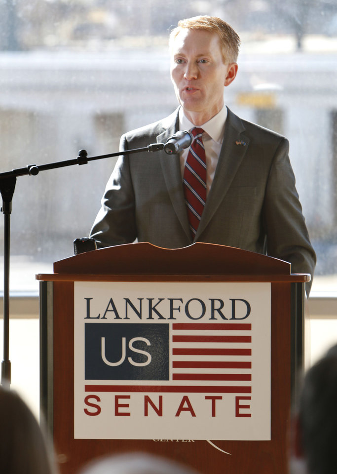 Photo - Oklahoma Congressman James Lankford announces his run for the Senate seat being vacated by Sen. Tom Coburn, during a press conference at the Oklahoma History Center in Oklahoma City, OK, Monday, January 20, 2014.  Photo by Paul Hellstern, The Oklahoman