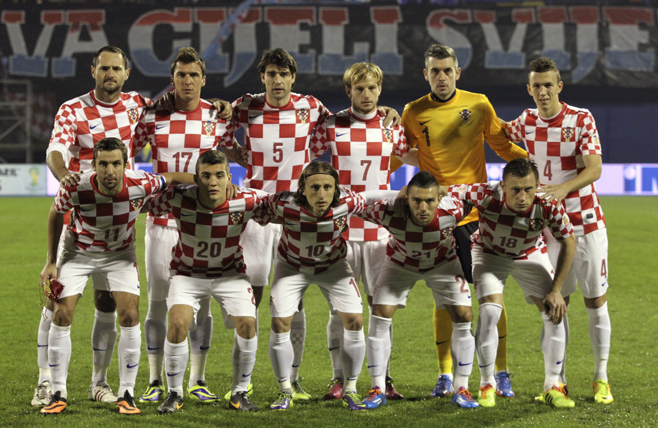 Photo - FILE - In this Nov. 19, 2013 file photo, Croatia soccer team poses prior to the start the World Cup qualifying soccer match between Croatia and Iceland in Zagreb, Croatia. Background from left: Josip Simunic, Mario Mandzukic, Vedran Corluka, Ivan Rakitic, Stipe Pletikosa and Ivan Perisic. Foreground from left: Darijo Srna, Mateo Kovacic, Luka Modric, Danijel Pranjic and Ivica Olic.  (AP Photo/Darko Bandic, File)