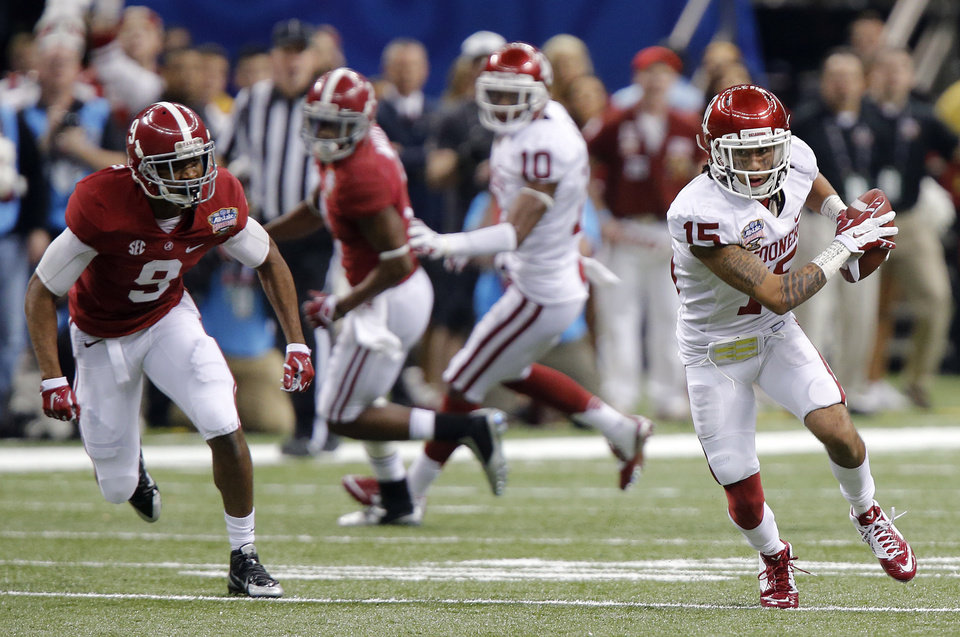 Oklahoma's Zack Sanchez (15) makes an interception on a pass for Alabama's Amari Cooper (9) during the NCAA football BCS Sugar Bowl game between the University of Oklahoma Sooners (OU) and the University of Alabama Crimson Tide (UA) at the Superdome in New Orleans, La., Thursday, Jan. 2, 2014.  .Photo by Chris Landsberger, The Oklahoman