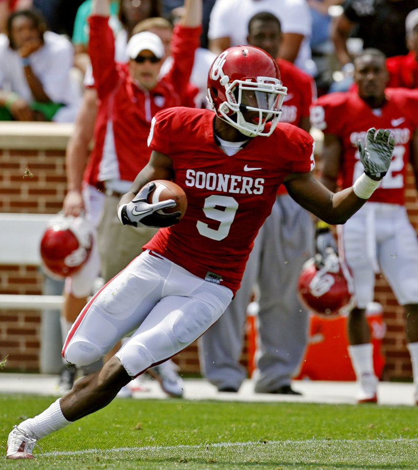 Gabe Lynn (9) intercepts a pass during the University of Oklahoma Sooner's (OU) Spring Football game at Gaylord Family-Oklahoma Memorial Stadium on Saturday, April 16, 2011, in Norman, Okla.  