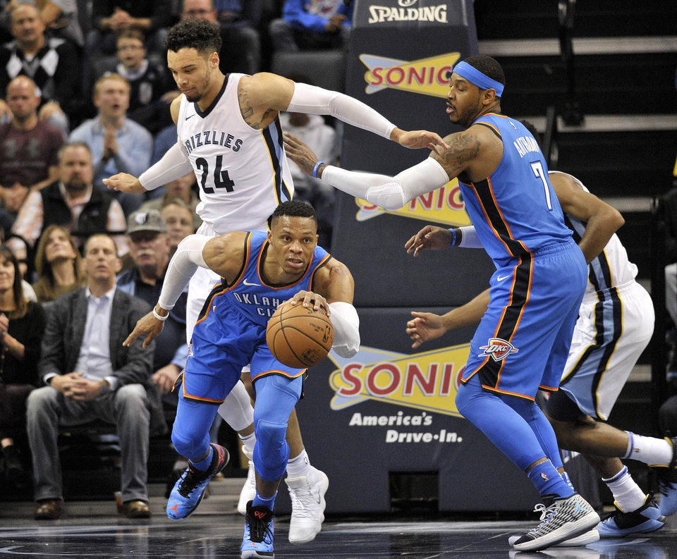 Photo -  Oklahoma City Thunder guard Russell Westbrook grabs a loose ball ahead of Memphis Grizzlies forward Dillon Brooks as Thunder forward Carmelo Anthony moves for position during Saturday's game. [AP Photo]