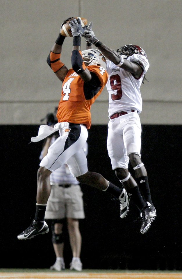 OSU's Justin Gilbert (4) makes an apparent interception on a pass intended for Troy's Jason Bruce (9). The interception was called back after a penalty on the play during the college football game between the Oklahoma State University Cowboys (OSU) and the Troy University Trojans at Boone Pickens Stadium in Stillwater, Okla., Saturday, Sept. 11, 2010. Photo by Sarah Phipps, The Oklahoman