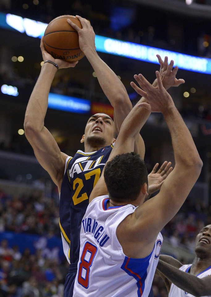 Photo - Utah Jazz center Rudy Gobert, left, of France, shoots as Los Angeles Clippers forward Hedo Turkoglu, of Turkey, defends during the first half of an NBA basketball game on Saturday, Feb. 1, 2014, in Los Angeles. (AP Photo/Mark J. Terrill)
