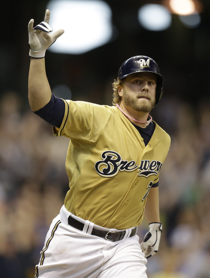 Photo - Milwaukee Brewers' Mark Reynolds reacts to his game-winning hit against the New York Yankees during the ninth inning of a baseball game Sunday, May 11, 2014, in Milwaukee. The Brewers won 6-5 (AP Photo/Jeffrey Phelps)